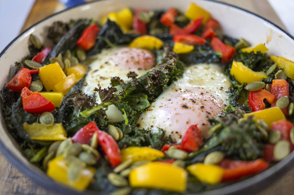 You will love this nutritious low carb breakfast of oven baked eggs with veggies to start off your day! All the goodness of eggs and veggies baked in one pan and ready to go. So easy, this keto breakfast will give you loads of energy to start the day! #paleo #paleobreakfast #ketorecipes #ketobreakfast #ketodiet #bakedeggs #eggs #grainfree #paleobreakfast #vegetarian