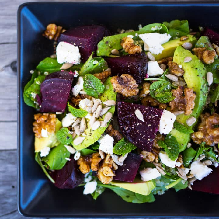 Close up of beetroot, avocado and quinoa salad on wooden background.