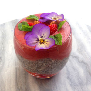 A delicious antixoidant rich layed smoothie with a creamy chia coconut layer, strawberries and acai berries.