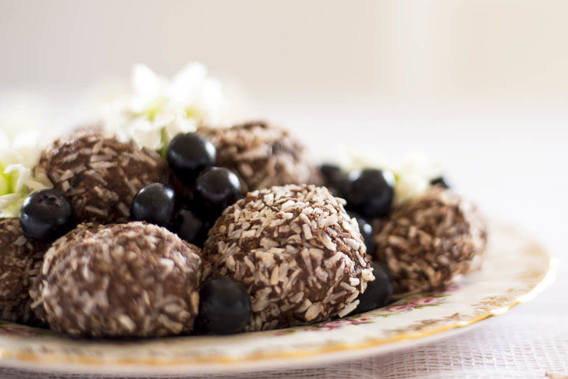 Creamy Blueberry Bliss Balls with Cacao & Coconut - A healthy and delicious sweet treat that will give you a burst of energy. Gluten Free, Paleo, Raw, Vegan, Dairy Free, Refined Sugar Free.
