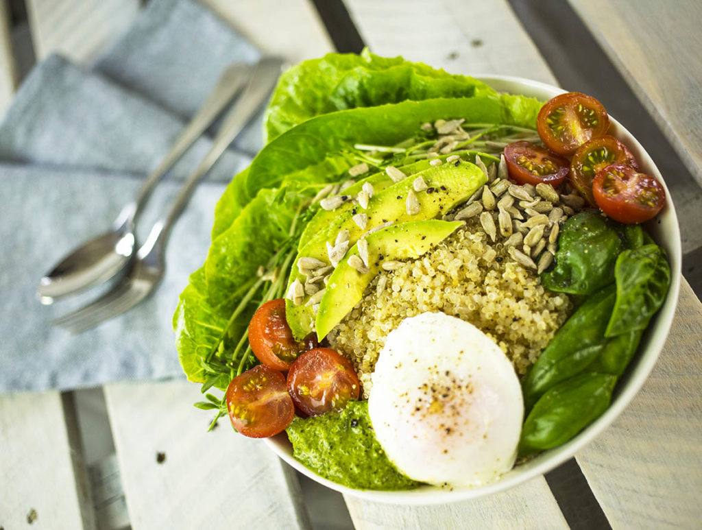 Quinoa Breakfast Bowl with Poached Eggs & Pesto
