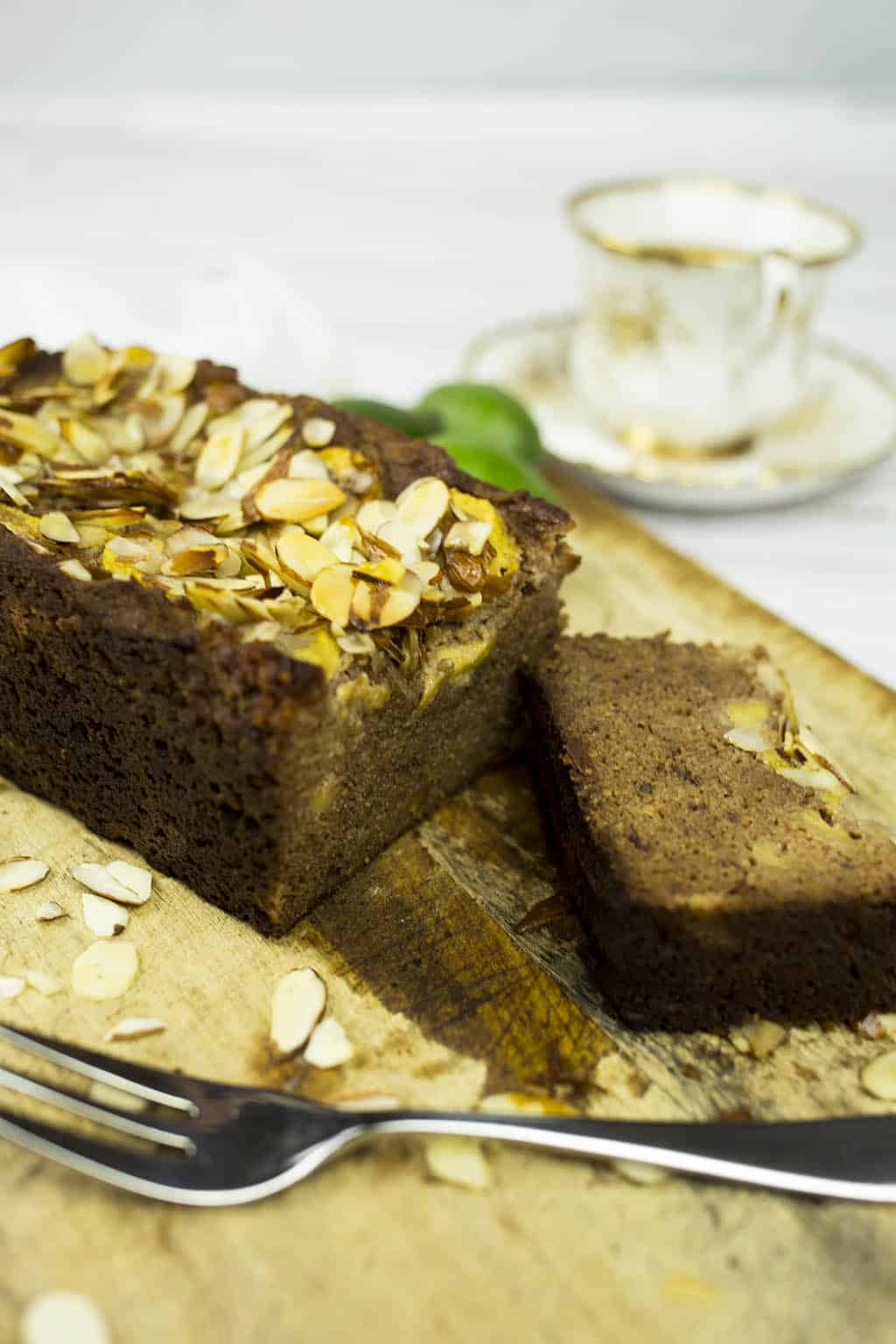 Feijoa and Banana Bread with slice cut and cup of tea