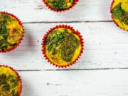 Healthy veggie egg muffins with broccoli, spinach, tomatoes and pesto, a healthy and tasty paleo breakfast or snack.