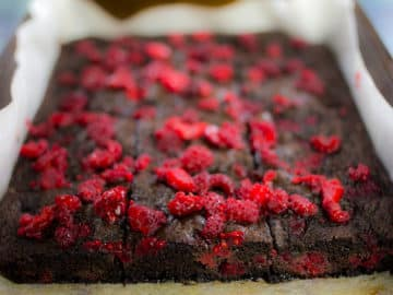 Close up of chocolate raspberry brownies in baking tray
