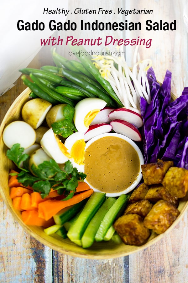 Gado Gado Salad (Indosian Salad) with peanut dressing. A healthy salad full of vegetables, can be served as a bowl or a platter to share.#gadogado #indonesianfood #glutenfree #vegetarian #glutenfreemain #salad #vegetariandinner #healthydinner #tempeh