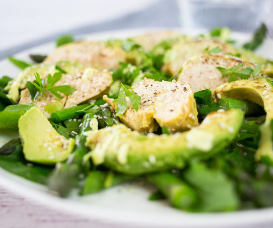 Chicken & Avocado Salad close up with glass of water