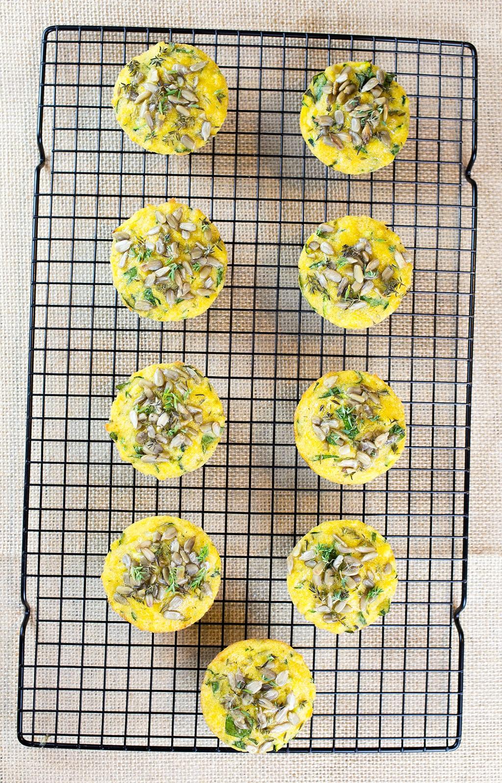 Birdseye view of gluten free savoury muffins on baking tray.