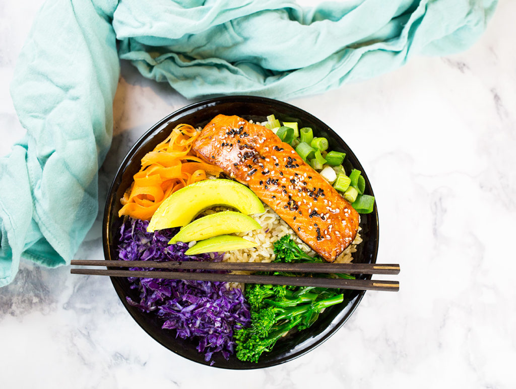 Gluten Free Teriyaki Salmon Bowl with rice, salad and chopsticks
