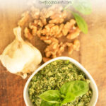 Kale, Basil & Walnut Dairy Free Pesto. This vegan pesto is so quick and easy, a tasty way to get more greens into your family! A vegan pesto that goes perfectly on your favorite platter. #veganpesto #dairyfreepesto #paleo #glutenfree #kale #basil #kalepesto #basilpesto #pesto #vegan #dairyfree #healthypesto