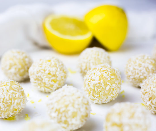These creamy lemon coconut bliss balls make a tasty healthy snack - they are low carb, high protein, gluten, dairy and refined sugar free. With a delicious blend of zesty lemon and creamy coconut these paleo energy balls are an easy to make no bake snack! They are a low carb snack that you can grab n go! #paleo #paleodiet #cleaneating #lemon #energyballs #cleaneating #paleorecipes #lowcarb #lowcarbrecipes #energybites #glutenfreerecipes #dairyfreerecipes