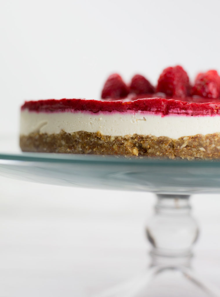 This creamy vegan raspberry cheesecake makes a delightful fresh and fruity dessert and requires no baking. Smooth, creamy, with the right balance of tart and sweet from the raspberries, this dessert is a real crowd pleaser. This raspberry cheesecake is vegan, gluten free, dairy free and paleo.#paleorecipes #vegancheesecake #raspberries #raspberrycheesecake #vegandessert #dairyfree #glutenfreedessert #lowcarbdessert