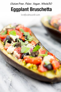 This healthy eggplant bruschetta recipe makes a healthy alternative to your classic bruschetta using delicious baked eggplant as the base. Topped with pesto, Mediterranean style veggies and dollops of cashew cheese this eggplant brucchetta recipe will become a new household favourite. Gluten Free, Paleo, Vegan and Whole 30 compliant.#eggplant #bruschetta #paleorecipes #appetizer #paleo #glutenfreerecipes #dairyfree #grainfree #mediterraneandiet