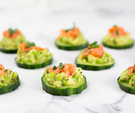 These smoked salmon cucumber bites with avocado pea smash make the perfect healthy appetizer. This easy appetizer requires no baking just keep in the fridge until ready to serve. Paleo, Whole30, low carb, dairy free and gluten free.#paleorecipes #salmon #appetizer #appetizerrecipeslow-carb #avocadoappetizerrecipes #avocado #salmonrecipes #lowcarbideas #whole30