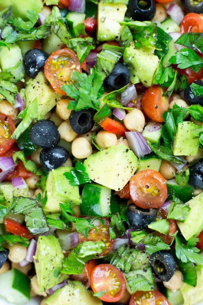 You will love this easy to make Mediterranean Chickpea Salad. Full of vibrant, fresh and tasty vegetables this vegan chickpea salad is a crowd pleaser. Gluten Free & Vegan. #glutenfreerecipes #chickpeas #chickpeasalad #vegansalad #Mediterraneanrecipes #Mediterraneanfood #veganrecipes #healthyrecipes