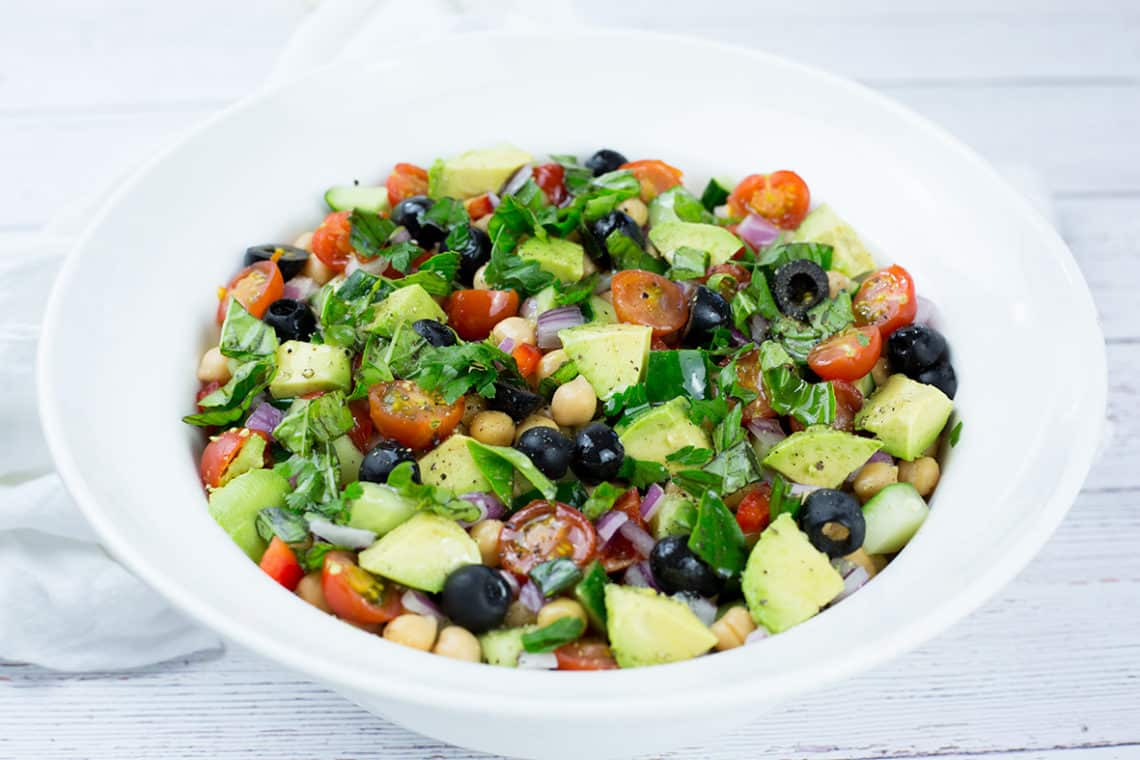 You will love this easy to make Mediterranean Chickpea Salad. Full of vibrant, fresh and tasty vegetables this vegan chickpea salad is a crowd pleaser. Gluten Free & Vegan. #glutenfreerecipes #chickpeas #chickpeasalad #vegansalad #Mediterraneanrecipes #Mediterraneanfood #veganrecipes #healthyrecipes