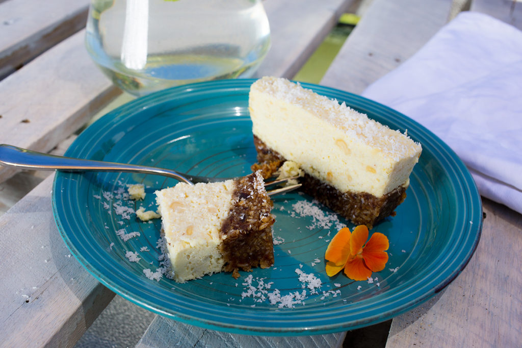 Pineapple and coconut Slice with Jug in background and fork
