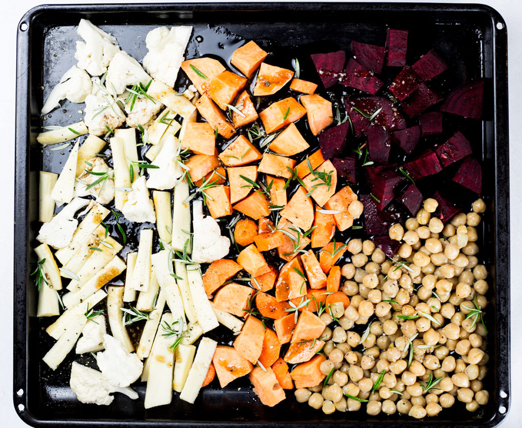Roasted vegetables on baking tray for roasted vegetable salad.