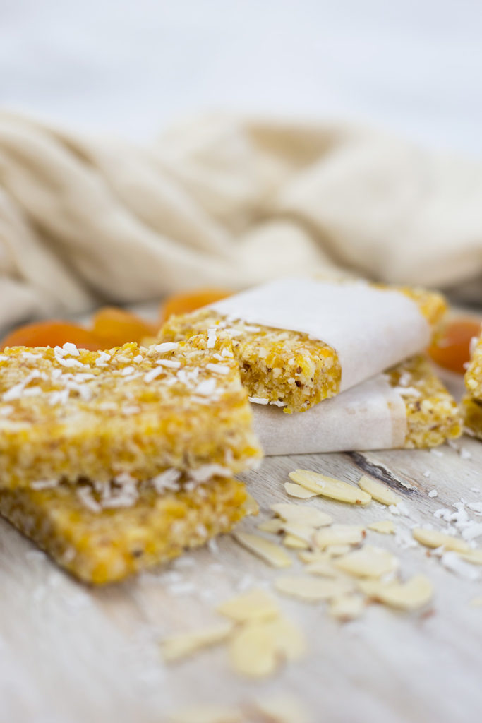 Close up of apricot slice with white wrappers.