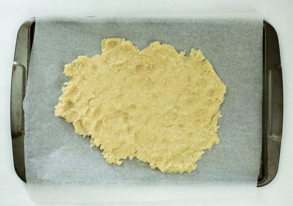 Dough on baking tray for coconut almond snowballs
