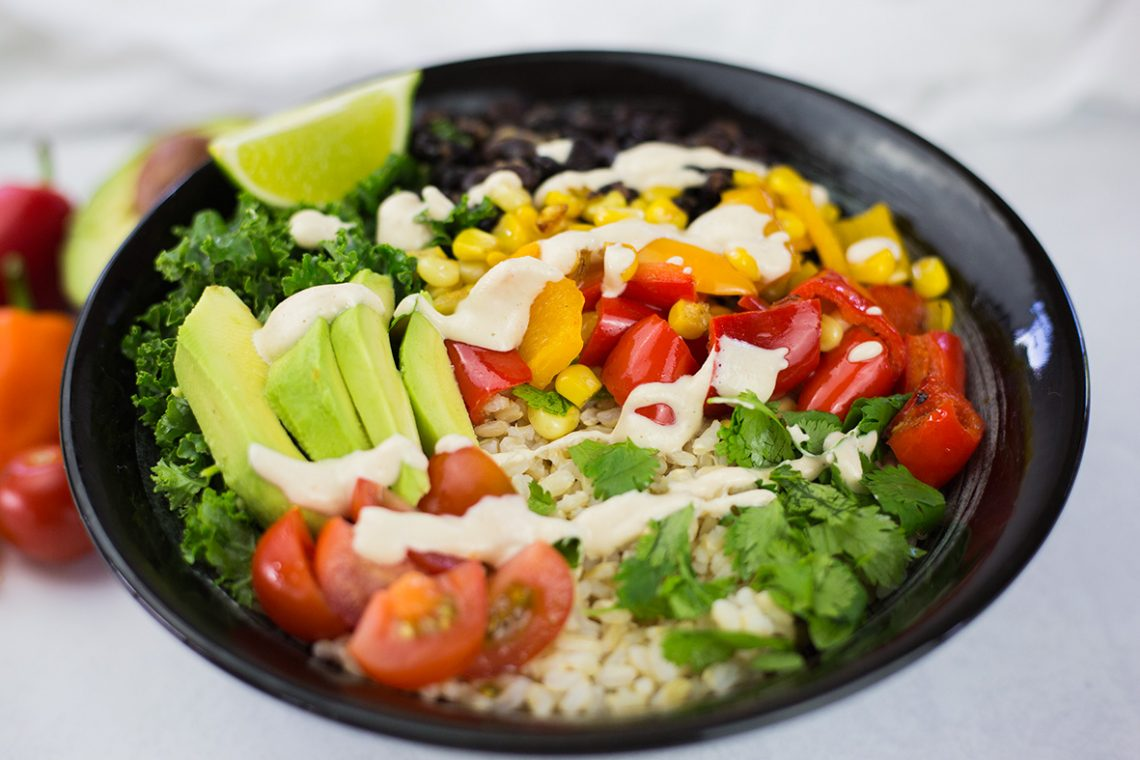Close up of Vegan Burrito Bowl with Cashew Dressing in black bowl