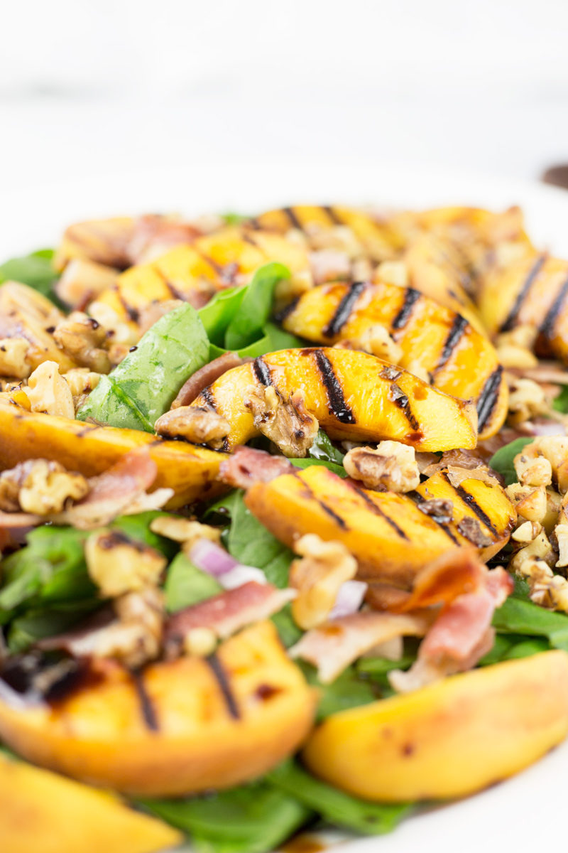 Close up of grilled peach and bacon salad.