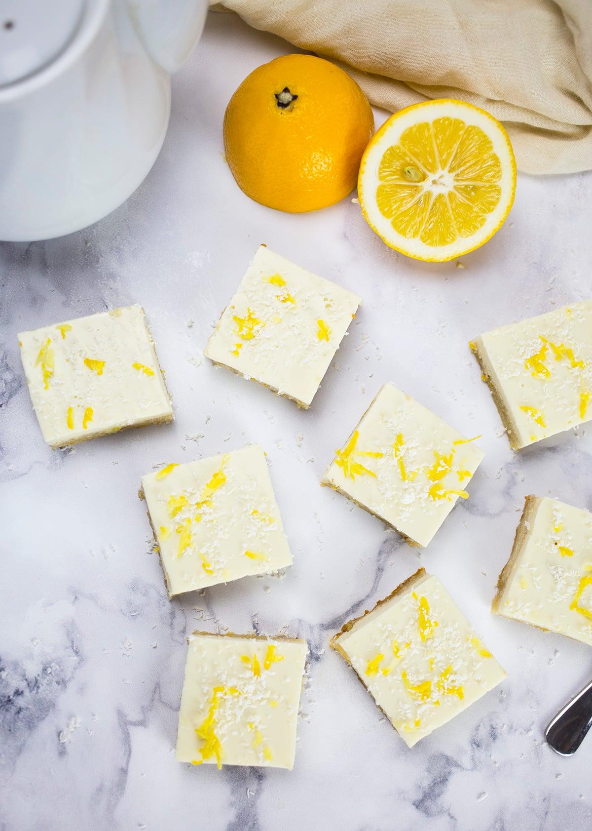 Birdseye view of lemon squares on marble background.