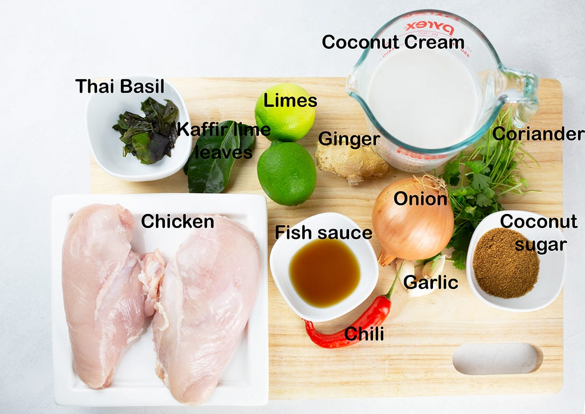 Ingredients for coconut lime chicken prepared and placed on chopping board.
