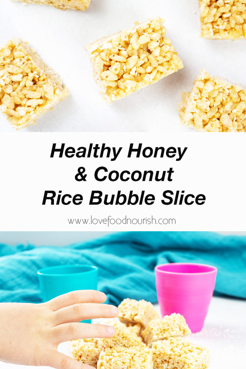 Rice buble slice on white background on top with bottom photo of childs hand reching for some with blue cloth in background. Text overlay syaing healthy honey and coconut rice bubble slice.